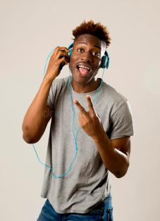 black-student-man-headphones-mobile-phone-listening-to-music-dancing-singing-young-attractive-song-happy-88353451